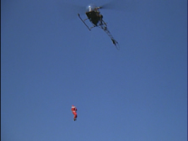 Santa Claus dropping out of a chopper